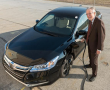 University of Delaware's Willett Kempton with a Honda Accord Plug-In Hybrid