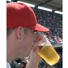 man drinking beer at stadium